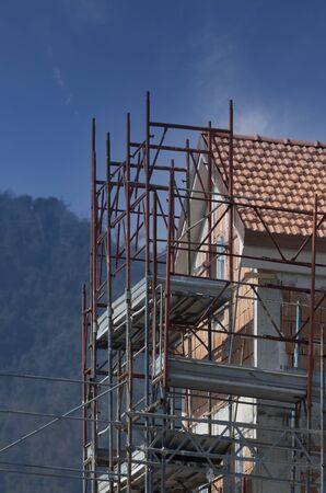 Scaffolding outside a house in construction in la spezia