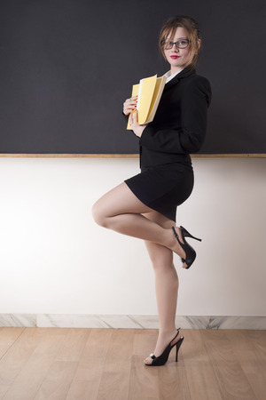 Beautiful Young Sexy Teacher Standing Near The Blackboard