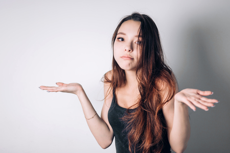 Photo pour Closeup portrait puzzled clueless young woman with arms out asking what is problem who cares so what I don't know. Negative human emotion face expression reaction perception - image libre de droit
