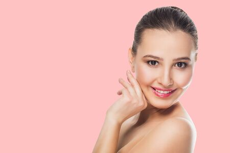 Photo for beautiful brunette girl with delicate make-up on pink background looks with a smile at the camera Spa care open shoulders cosmetics skin - Royalty Free Image