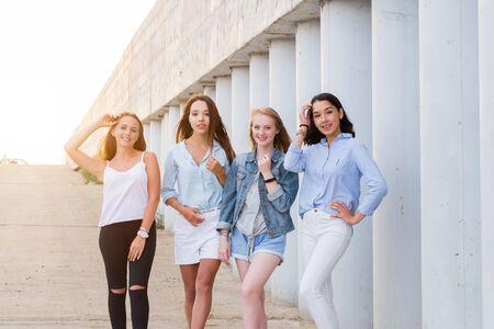 Photo pour Four best girlfriends looking at camera together. people, lifestyle, friendship, vocation concept - image libre de droit