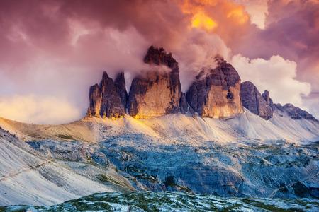 Majestic foggy view of the National Park Tre Cime di Lavaredo with rifugio Locatelli. Dolomites, South Tyrol. Location Auronzo, Italy