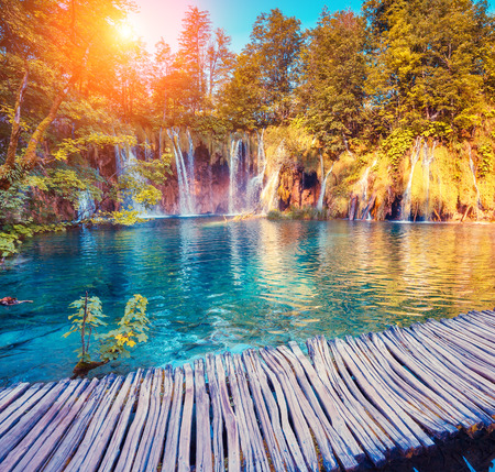 Majestic view on turquoise water and sunny beams in the Plitvice Lakes National Park in Croatia