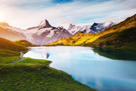 Photo pour Panorama of Mt. Schreckhorn and Wetterhorn. Popular tourist attraction. Dramatic and picturesque scene. Location place Bachalpsee in Swiss alps, Bernese Oberland, Grindelwald, Europe. Beauty world. - image libre de droit