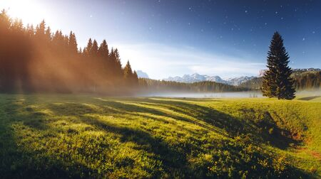 Foto de Misty summer night in the Durmitor National park. Location place village Zabljak, Montenegro, Balkans, Europe. Scenic image of the alpine valley. Magic astrophotography. Discover the beauty of earth. - Imagen libre de derechos