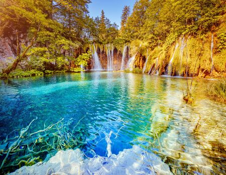 Peaceful view on paradise waterfalls of Plitvice Lakes National Park. Location place of the Croatian famous resort, Balkans, Europe. Most popular tourist destination. Discover the beauty of earth.