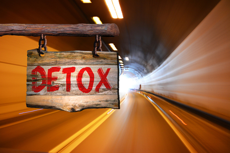 Detox motivational phrase sign on old wood with blurred background