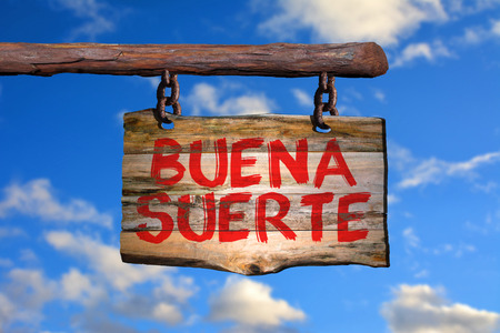Buena suerte motivational phrase sign on old wood with blurred background