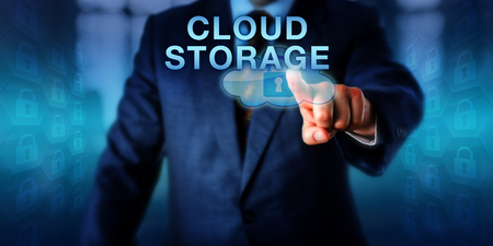 Service provider is pushing CLOUD STORAGE on a touch screen interface. Business services metaphor and technology concept for secure data storage via remote servers with a virtualized infrastructure.