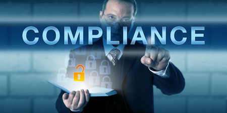 Business manager is touching COMPLIANCE on a virtual