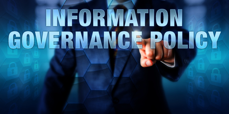 Photo pour IT manager is pushing INFORMATION GOVERNANCE POLICY on a touch screen interface. - image libre de droit