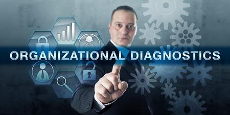 Photo pour Corporate consultant is pressing ORGANIZATIONAL DIAGNOSTICS on an interactive touch screen. - image libre de droit