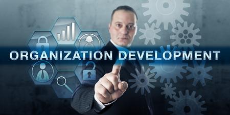 Photo pour Entrepreneur is pushing ORGANIZATION DEVELOPMENT on an interactive touch screen display. - image libre de droit