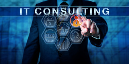 Photo pour Corporate manager pushes IT consulting on an interactive touch screen interface. Business metaphor and information technology concept for consultative services relating to internet strategy planning. - image libre de droit