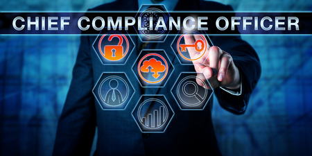 Photo pour Business executive is pushing CHIEF COMPLIANCE OFFICER on an interactive touch screen interface. Business challenge metaphor for corporate governance, regulatory compliance and corporate executives. - image libre de droit