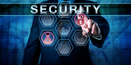 Foto de Male corporate administrator is touching SECURITY on an interactive virtual control display. Business risk metaphor and information technology concept for physical security and computer security. - Imagen libre de derechos
