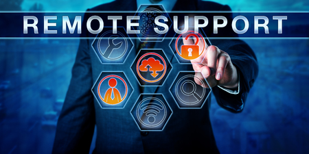 Male corporate IT technician is pressing REMOTE SUPPORT on an interactive touch screen monitor. Business metaphor and information technology concept for desktop sharing with a distant IT help desk.