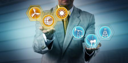 Foto de Unrecognizable manager raising renewable energy sector icons above fossil fuel symbols. Industry, business and technology metaphor for transition to alternative power generation, sustainability. - Imagen libre de derechos