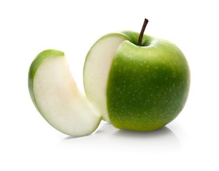 green apple and slice isolated over a white background