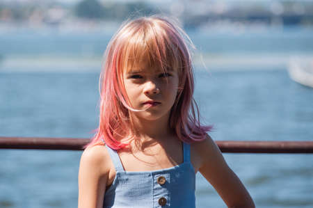Photo for cute child girl portrait . Outdoor portrait of cute little girl in summer day. Portrait of a little girl with pink hair. Child 7-8 years old. Teenager - Royalty Free Image