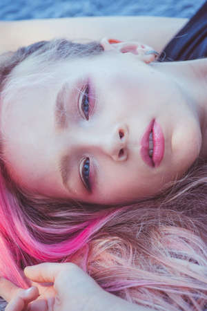 Photo pour girl portrait. Outdoor portrait of cute little girl in summer day. girl with pink hair. Child 9-10 - image libre de droit