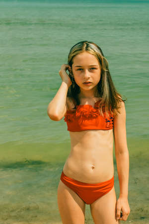 Photo pour girls in summer time. Girl in a swimsuit on vacation. Teenager girl 10 years old. Summer portrait - image libre de droit