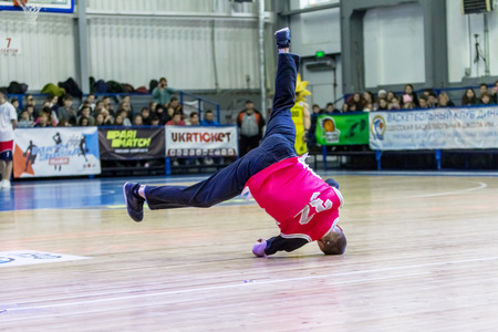 Odessa, Ukraine - February 16, 2019: street dancers, children and teenagers dance break dance on the basketball court during the commercial break. Hip-hop dancers perform at the sports arena