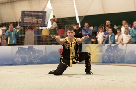 Photo pour ODESSA, UKRAINE - October 1, 2019: Wushu athlete during the Wushu competition among children. Young athletes in competitions perform Chinese martial arts called Shaolin Kung Fu (Shaolin Wushu) - image libre de droit