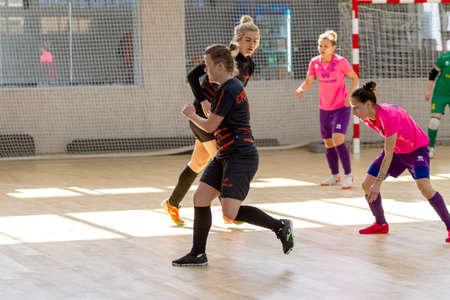 Photo pour ODESSA, UKRAINE - March 13, 2020: Futsal Cup of Ukraine, futsal among students. During final match in futsal among student teams. Beautiful sports girls play mini football on parquet floor - image libre de droit