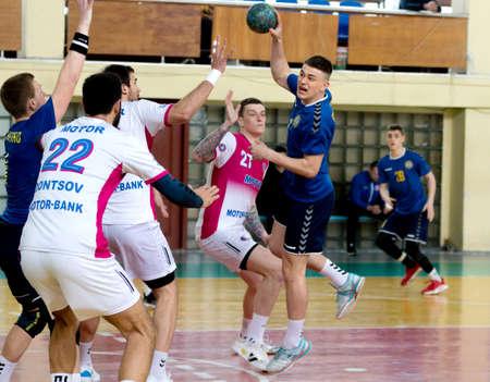 Photo for ODESSA, UKRAINE - April 23, 2021: Handball. Federation of Men's Handball of Ukraine. Match Odessa - Motor Sich, Zaporozhye - white. Action during men's handball game. Hard attacking with ball - Royalty Free Image
