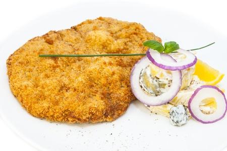 Schnitzel vegetable salad at restaurant