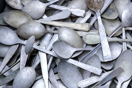 Background of old dirty cutlery close-up photo