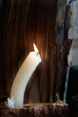 night light candle on the old dark wood