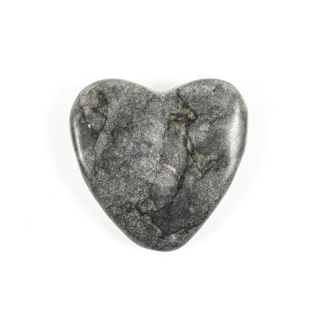 Heart shaped stone on white background