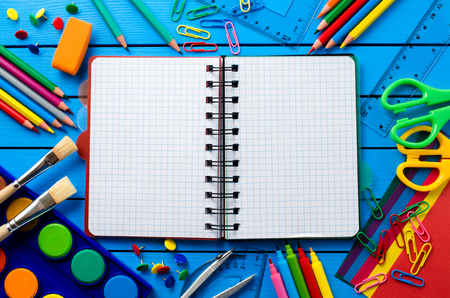 Photo for School supplies on blue wooden table - Royalty Free Image