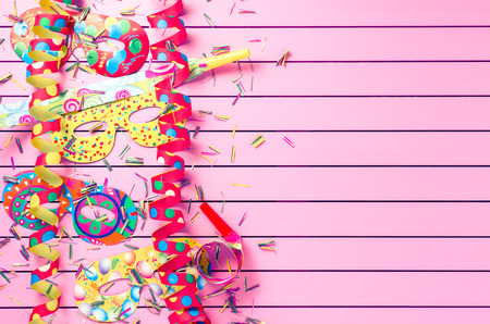 Photo for Colorful party decoration on pink background - Royalty Free Image
