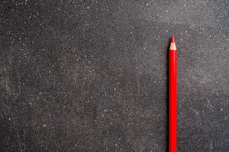 Foto de Red pencil on dark table - Imagen libre de derechos