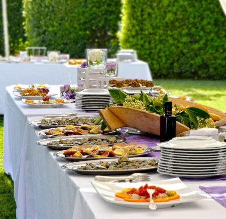 Outdoor banquet with delicious fresh dishes