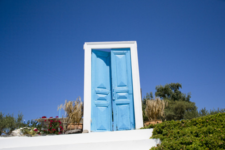 exterior door ajar - blue and white