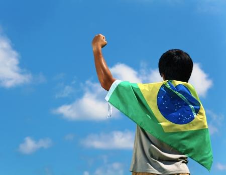 Brazil supporter hand up