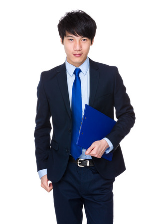Confident relaxed Asian businessman standing with a folder