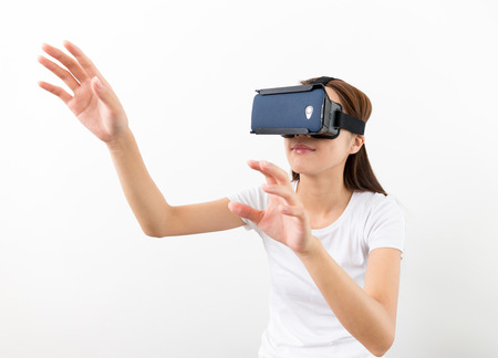 Asian woman using the virtual reality headset and two hand touch on air