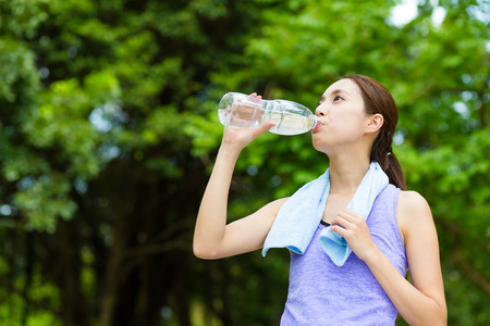 Woman drink of the water with running tracksuit