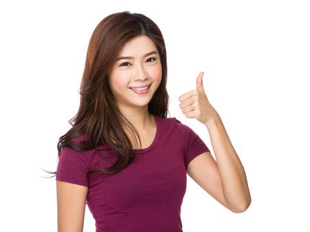 Photo pour Asian Young woman with thumb up gesture - image libre de droit
