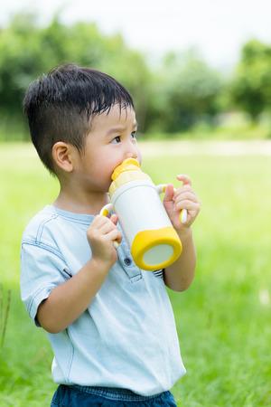 Cute boy drinking water
