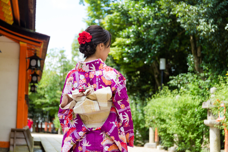 The back view of Young Woman wearing the kimono dress