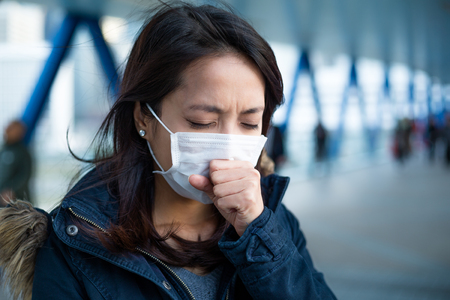Photo pour Woman suffer from cough with face mask protection - image libre de droit