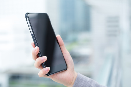Business woman hold with smart phone