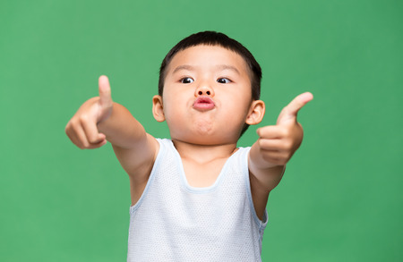 Little boy showing thumb up gesture