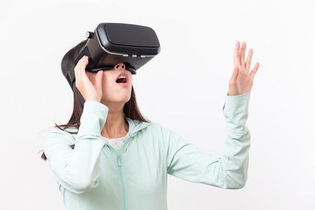 Photo pour Woman using VR device - image libre de droit